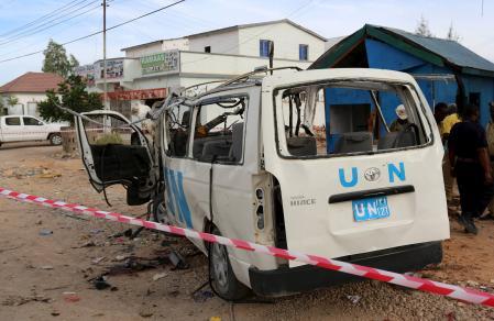 A U.N. van is seen damaged by an explosive device outside the U.N. compound in Garowe. (Courtesy REUTERS/Feisal Omar)
