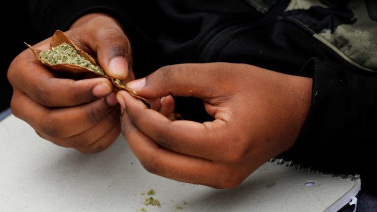 Marijuana Legislation: People roll a marijuana joint on the informal cannabis holiday, 4/20.