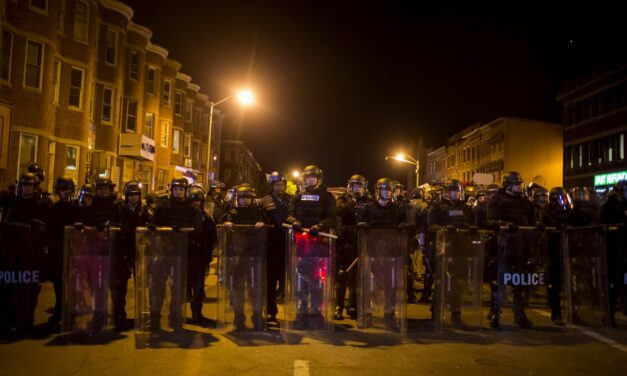 Baltimore police enforce city-wide curfew following riots
