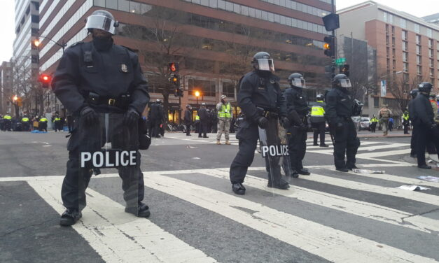 Protestors clash with police and civilians during inauguration