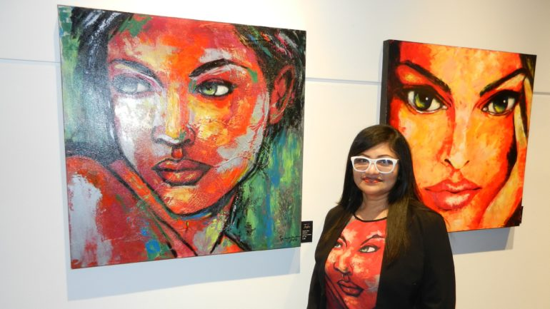Tanzina Amin with some of her paintings