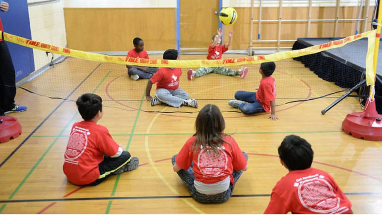 Children at Sloane Public School in Toronto Playing Sitting Volleyball