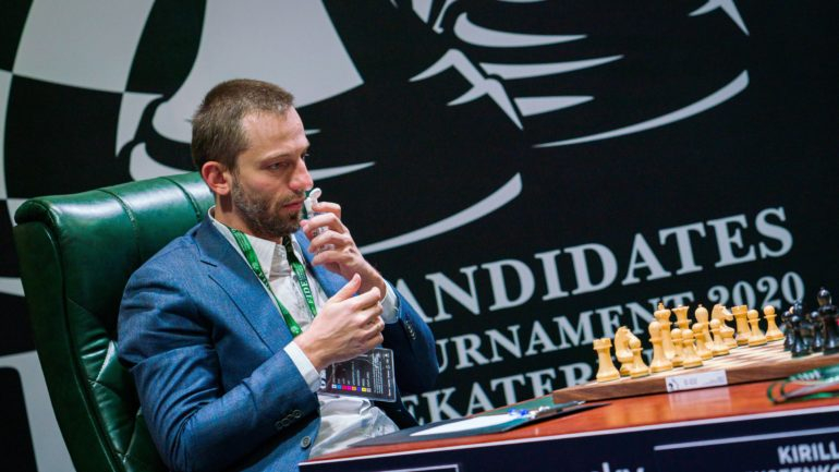 Russian chess player Alexander Grischuk smells hand sanitiser as he takes part in the Candidates Tournament, in Yekaterinburg, Russia Mar. 17, 2020. (Lennart Ootes/FIDE/Handout via REUTERS)