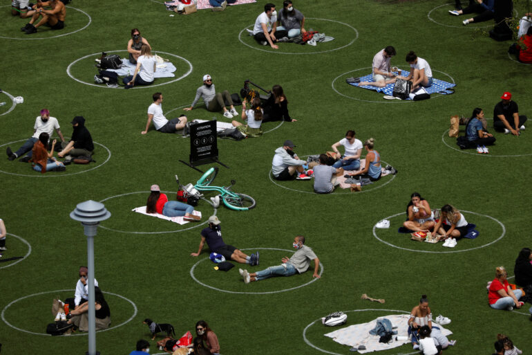 People in Domino Park are seen in circles painted as guidelines for social distancing during the coronavirus outbreak in Brooklyn on May 24. (REUTERS/Andrew Kelly)