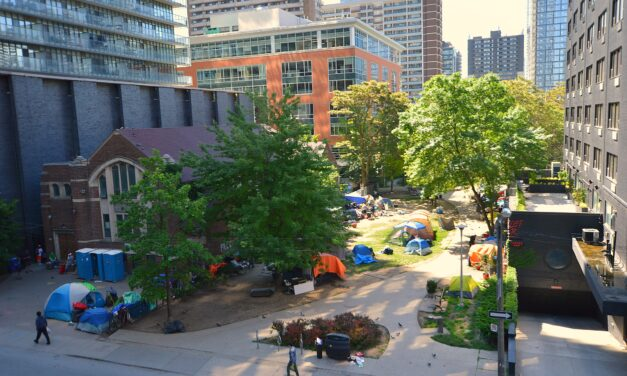 Residents of Moss Park encampment fight against moving to shelters