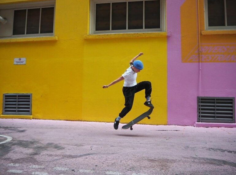 Emma Stushnoff doing an ollie in an alley way.