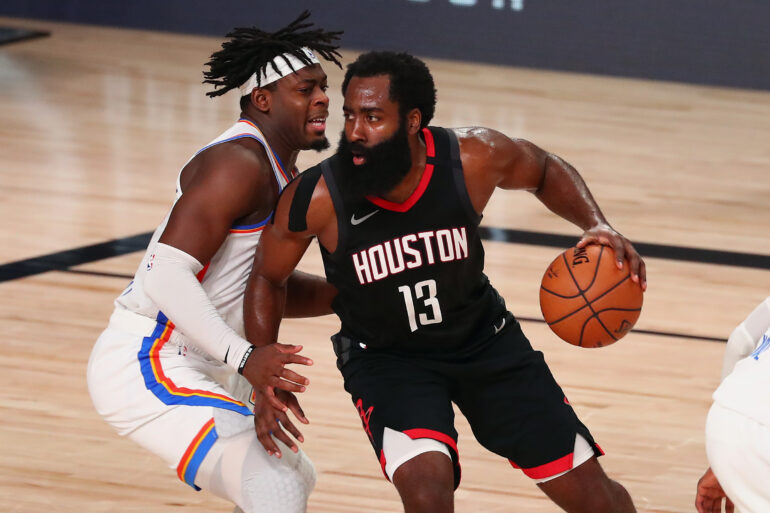 Aug 24, 2020; Lake Buena Vista, Florida, USA; Houston Rockets guard James Harden (13) drives against Oklahoma City Thunder guard Luguentz Dort (left) during the second half in game four of the first round of the 2020 NBA Playoffs at AdventHealth Arena. Mandatory Credit: Kim Klement-USA TODAY Sports