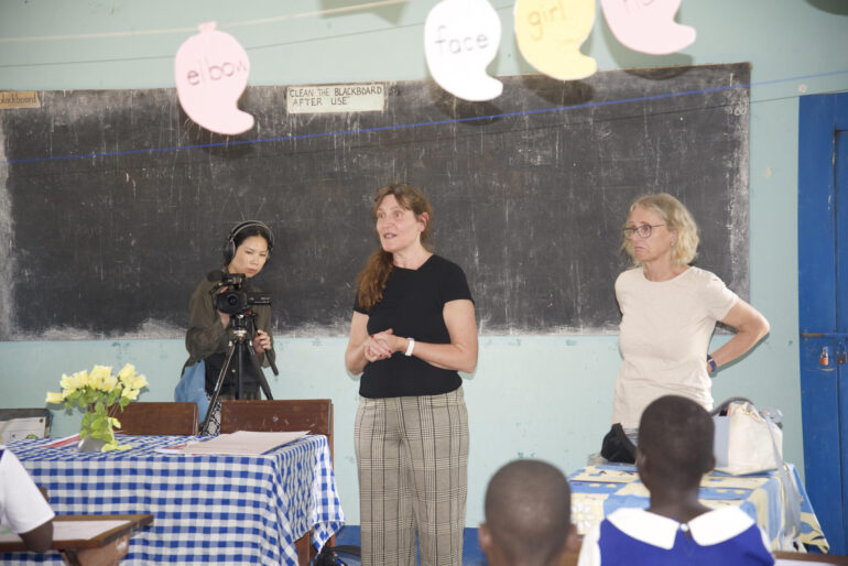 Lucy Lau behind camera for DUVE Art Therapy workshop at Arua Hill Primary School in North Western Uganda.