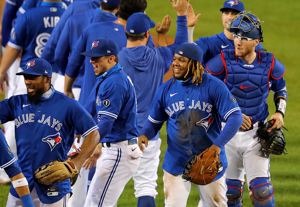 BUFFALO, NY - SEPTEMBER 24: The Toronto Blue Jays celebrate a win against the New York Yankees at Sahlen Field and celebrate a 2020 postseason berth on September 24, 2020 in Buffalo, New York. The Blue Jays are the home team due to the Canadian government's policy on COVID-19, which prevents them from playing in their home stadium in Canada. Blue Jays beat the Yankees 4 to 1. (Photo by Timothy T Ludwig/Getty Images)