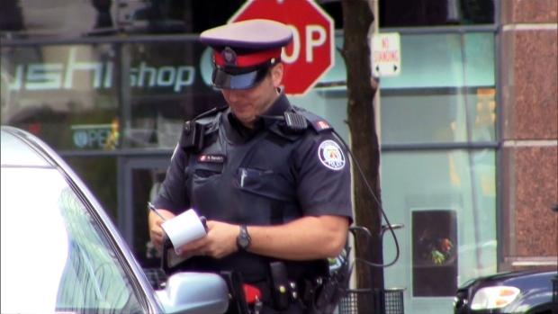 Toronto Police handing out fines to people.
