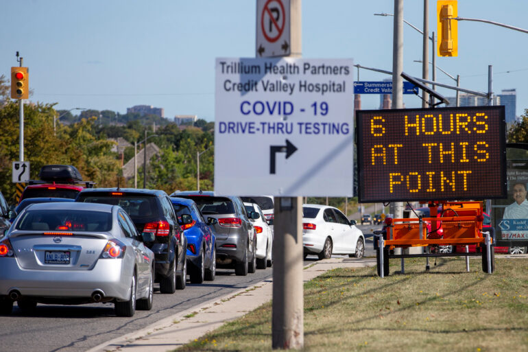 People wait in their cars at the Credit Valley Hospital Drive-Thru coronavirus disease (COVID-19) testing facility in Mississauga, Ontario, Canada September 18, 2020. REUTERS/Carlos Osorio