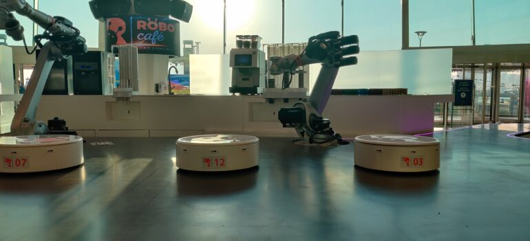 Robots working at the coffee station at RoboCafe which is the first autonomous cafe in Dubai.