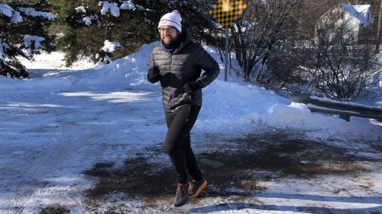 Jonathan Mogg running with a smile on his face in -17 weather in Sault. Ste. Marie, Ont.