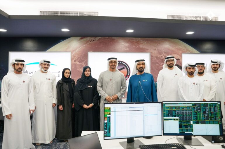 Mohammed Bin Rashid (in blue) along with the Emirates Mars Mission team at the Mohammed Bin Rashid Space Centre control room.