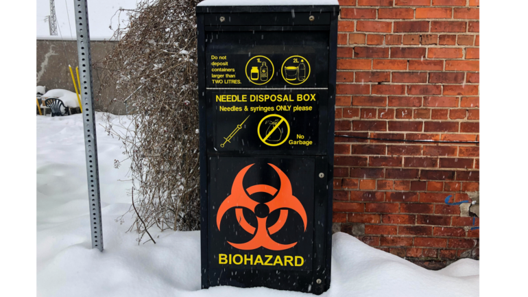 One of seven needle disposal boxes in Sault Ste. Marie, Ont. This box is located at Albert St. and Blutcher St. Part of the downtown core.