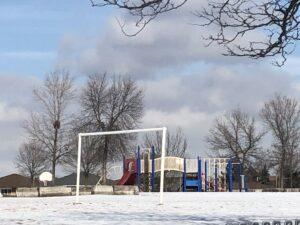 Image of an empty school playground.