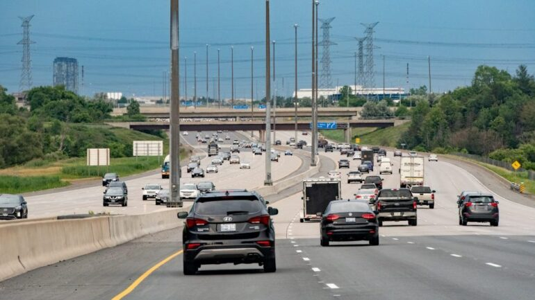 Cars driving on a 400 series highway in the Greater Toronto Area.