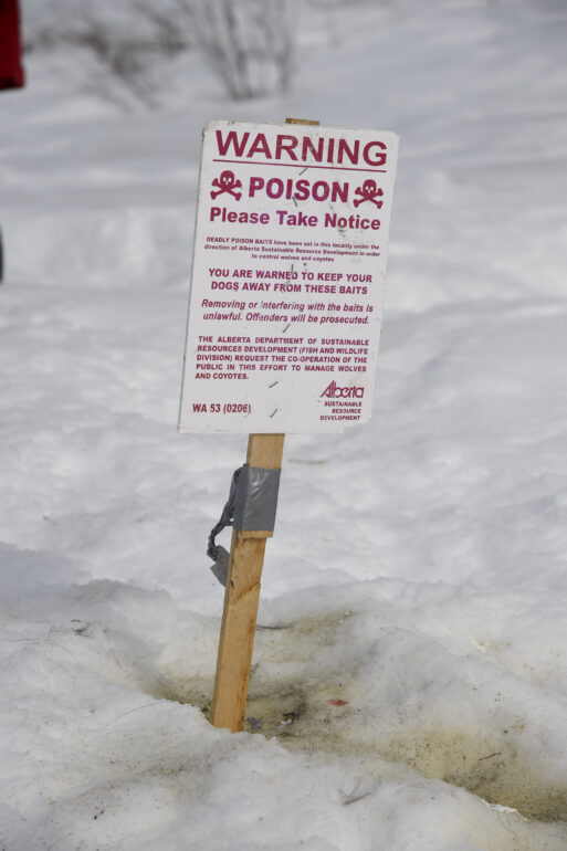 A warning sign in Alberta, noting the location of poison meant to kill wolves.