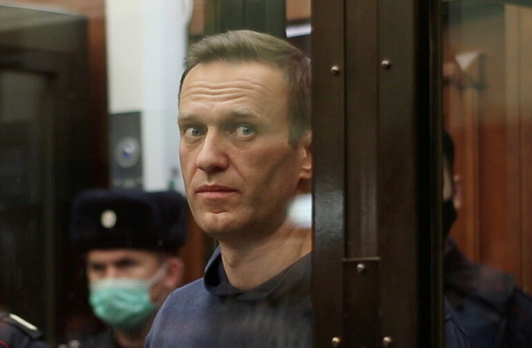 Russian opposition leader Alexei Navalny looks out of his glass cell during a sentencing hearing  in Moscow, Russia on Feb. 2 2021.