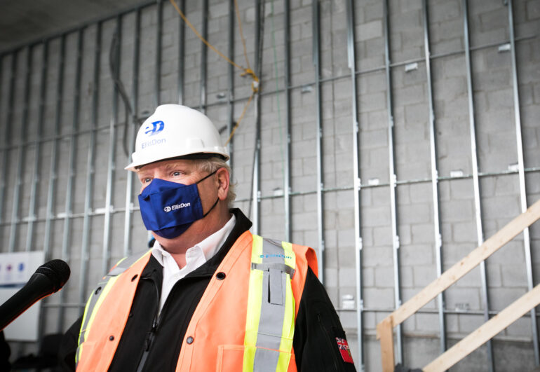 Premier Doug Ford speaking at an EllisDon construction site in February 2021. Ford's proposed changes include increasing individual contribution limits to political parties to $3,300.