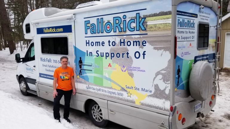Rick Fall standing beside his support RV. This RV will be his home away from home during his journey.