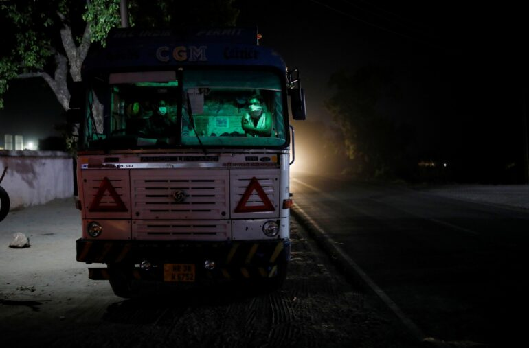 A driver waits April 22 for his turn to fill liquid oxygen in his tanker, to be transported to a COVID-19 hospital, amidst the spread of the coronavirus disease, in Ghaziabad, on the outskirts of New Delhi. Hospitals in parts of India face a shortage of oxygen as the number of cases rise.