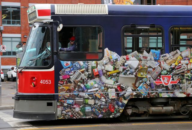 TTC Streetcar with photo of plastic recycling on the side of it