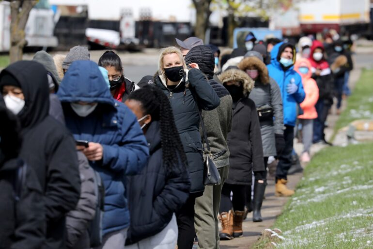 """Residents 18 years of age and older who live in coronavirus disease (COVID-19) """"hot spots"""" line up for a special a vaccination clinic run by Humber River Hospital&squot;s mobile team at Downsview Arena in Toronto on April 21, 2021."""