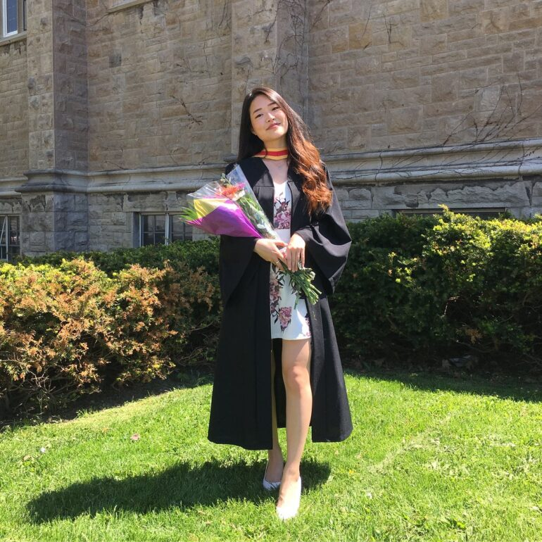 Melody Kang in her graduation attire outside Queen's University's John Deutsch University Centre in April 2018. Kang is a TikTok creator and said the new bill supports, rather than hurts, small and large independent content creators like her. Courtesy: Facebook/Melody Kang.