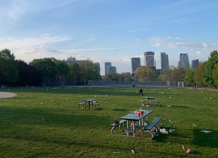 Trinity Bellwoods Park covered in garbage