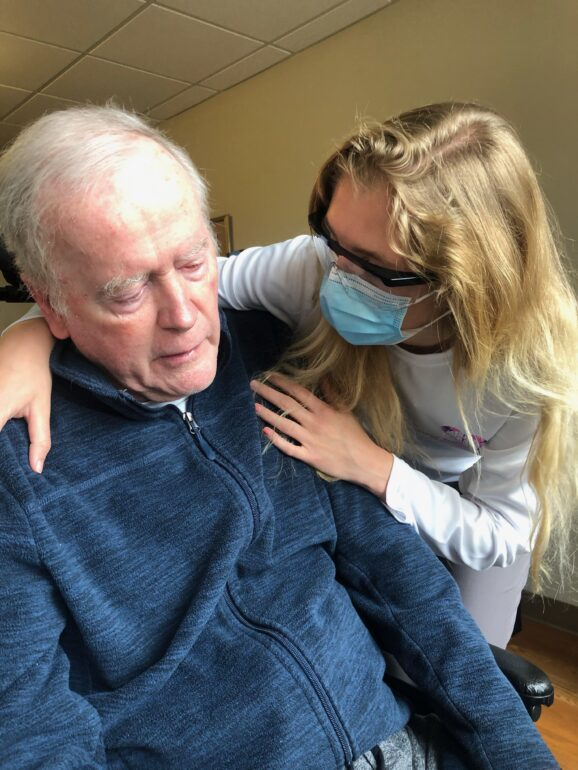 Wilson with one of her clients in Brantford, Ont. over the Victoria Day long weekend. Wilson said the province's decision to open long-term care homes to visits has let her company restart sessions with clients in some homes. Photo credit: Courtesy Mikaela Wilson