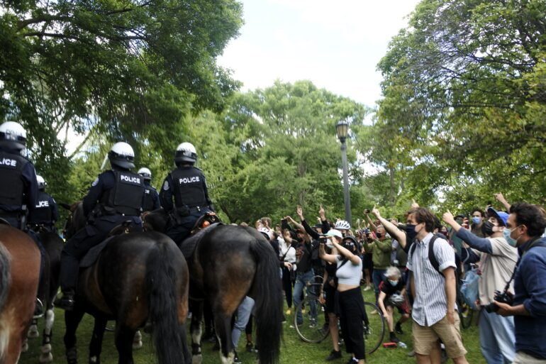 Mounted Police unit arrives at the scene when supporters started to get heated. They walked back and forth to scare the crowd away.
