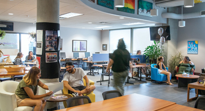 Students relax and hang out at an on-campus residence hall. Western will allow students 14 days after move-in to book an appointment for their COVID-19 vaccine if they have not already gotten one before coming to campus.