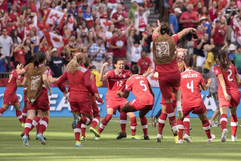 Canadian women's soccer team celebrating a win